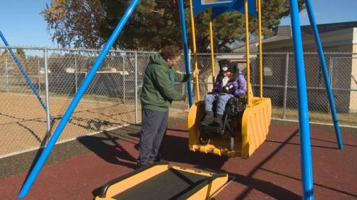 Wheelchair swing at the John Dolan School sensory playground.