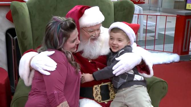 Sharing is caring: Santa pours 'milk' down boy's feeding tube in photo - National